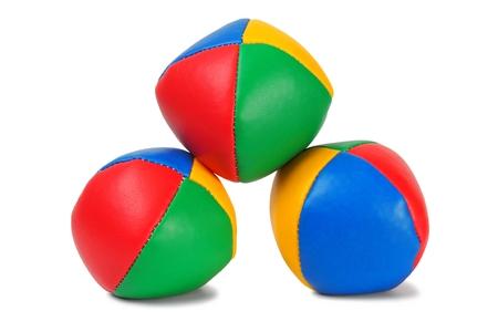 Three juggling balls on white background