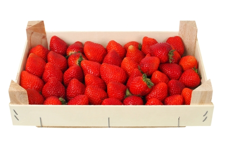 Strawberries in wooden box, isolated on white background Foto de archivo