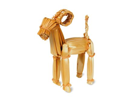 Toy goat made from straws isolated on white background