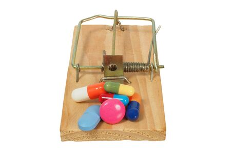 Mousetrap with medicine isolated on white background