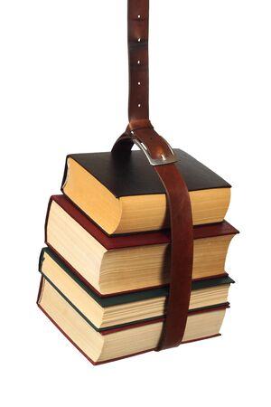 Books hanging on belt isolated on white background Stock fotó