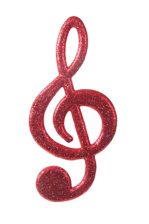 Red G-clef as Christmas decoration  isolated on white background