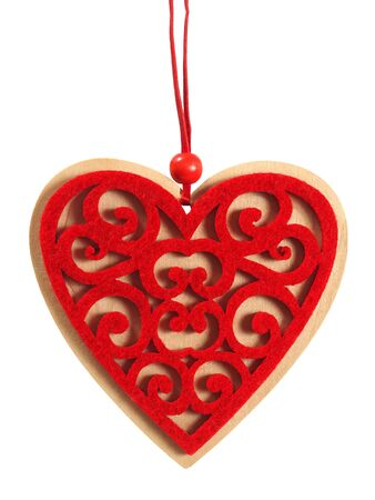 Red wooden heart with string on white background