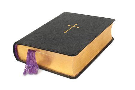 Libro de oración cristiana aislado sobre fondo blanco. Foto de archivo