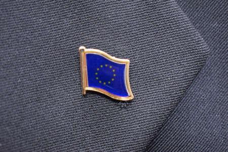 European Union Flag lapel pin on a suit. High-quality photo