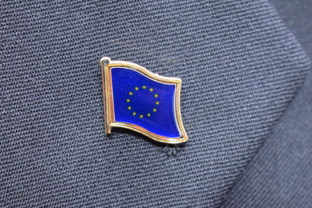 European Union Flag lapel pin on a suit. High-quality photo