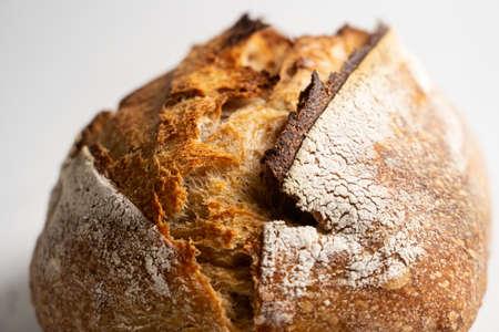 Fresh baked loaf of homemade sourdough bread 免版税图像