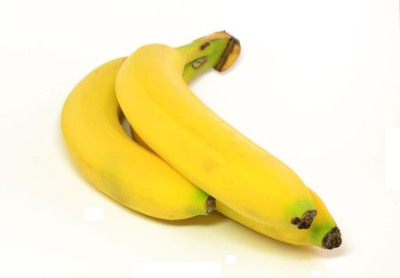 beautiful bunch of yellow delicious tasty bananas on white background