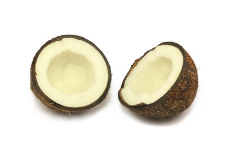 two halves of a coconut lying on a white background Stock Photo