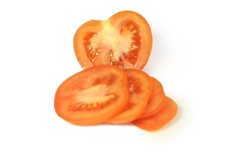 red tomato chopped circles lying on a white plate
