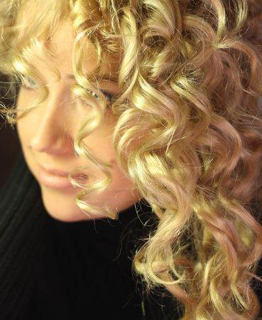 beautiful girl with long blonde curly hair healthy