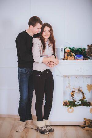 couple man and woman hugging  near the Christmas tree Stock Photo