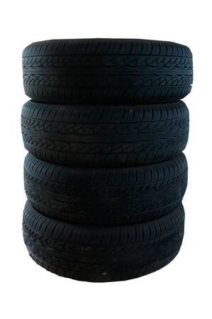 tires stacked up and isolated on white background photo