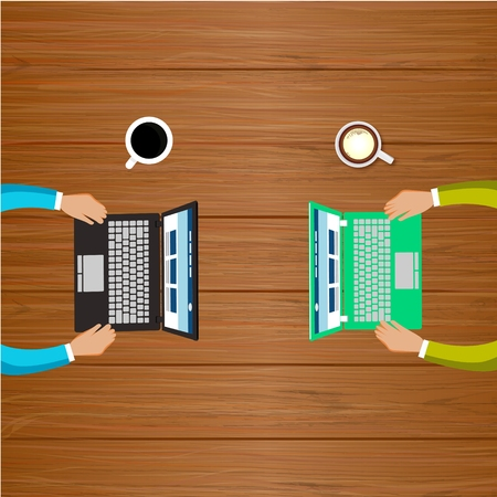 Two People Work with Computers