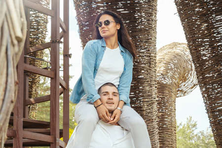 Young Couple having fun outdoors at sunny summer day. Reklamní fotografie