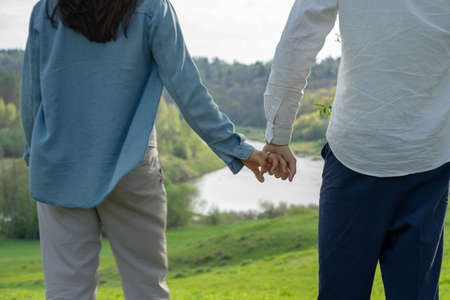 Couple of young beautiful man and woman hugging outdoors at sunny summer day at beautiful landscape background at countryside. Stock Photo - 124902247