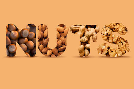 Creative Collage Made Of Different Nuts: Hazelnut, Almond, Peanut, Walnut With Realistic Shadows on Beige Background Archivio Fotografico
