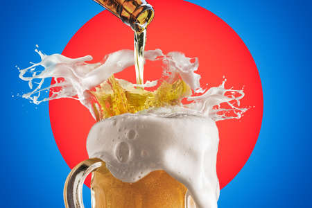 Creative Collage Of Beer Glass With Beer Splashes and Overflowing Foam on Bright Red and Vivid Blue Background.