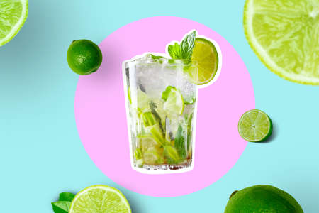 Creative Collage Of Glass With Mojito With Lime Slices And Limes on Bright Pink and Vivid Blue Geometric Abstract Background