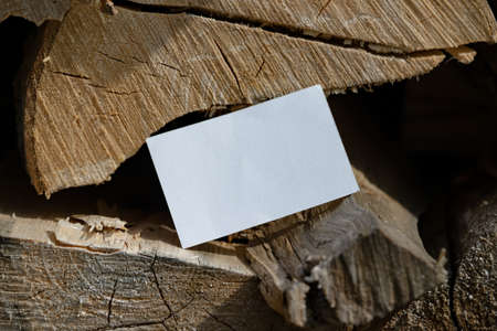 Close up Of White Blank Business Card With Empty Space on Firewood Background. Corporate Branding. Copy Space
