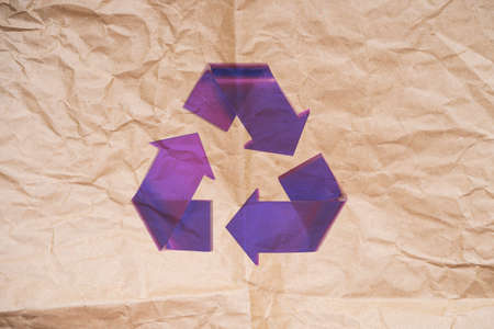 Violet Transparent Stylish Recycle Arrow on Biodegradable Paper Background. Reuse Sign. Eco Friendly and Environment Care Concept