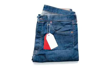 White and Red Blank Tag Price On Jeans on White Background. Copy Space. Empty Space. Promotion and Advertising. Template Design Archivio Fotografico