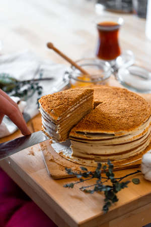 Homemade Honey Cake on Wooden Rustic Table, Russian Traditional Cuisine. Medovik