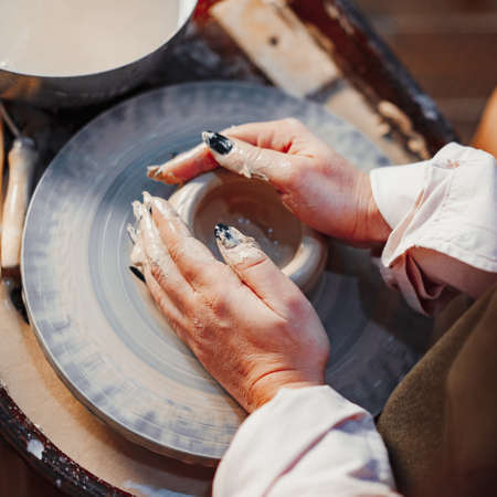 Close up of Woman Hands Working on Pottery Wheel With Clay