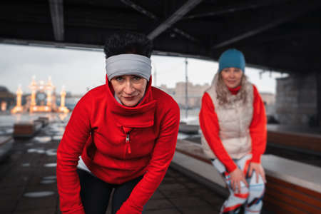 Healthy Middle Aged Women Warming Up And Stretching in Urban Environment. Active Lifestyle and General Self-Care Routines Of Mature Women