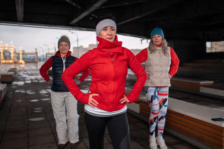 Mental and Physical Health at Senior Age. Middle Aged Women Exercising Outdoors. Living Full Life At Senior Age. Six Feet Of Social Distance Space