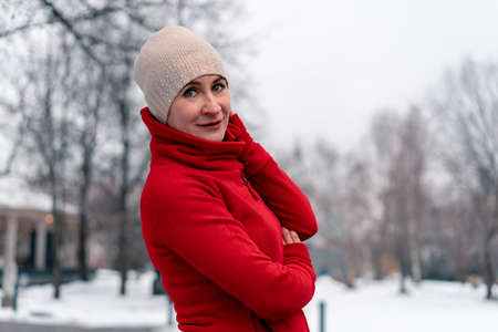 Beautiful Mature Woman In Red Bright Sportswear After Jogging And Running Outdoors With Park At Background. Active and Healthy Lifestyle at Middle Age 版權商用圖片