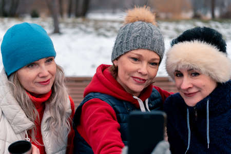 Mature Women Smiling and Making Selfie In Park After Active Outdoor Training