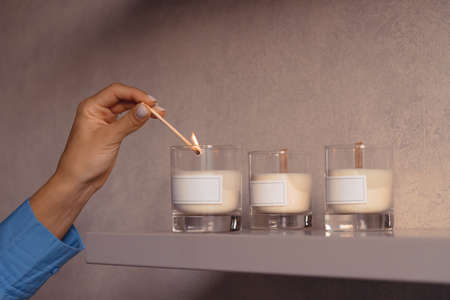 Woan Lighting Up Scented Candle In Glass With Blank White Label At Her Bedroom For Relaxation 版權商用圖片