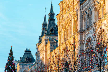 GUM At Red Square In Moscow. GUM Illuminated With Sun Light. Trees Decorated With Christmas Toys Decorations