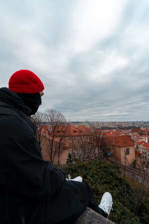 Young man sitting with beautiful view of Prague.