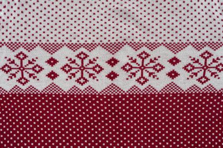 Norwegian pattern of red and white yarn.