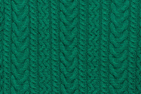Green knitted textured sweater pattern. 版權商用圖片