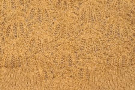 Yellow knitted textured sweater pattern. 版權商用圖片