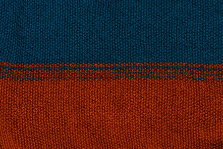 Blue and red knitted textured sweater pattern. 版權商用圖片