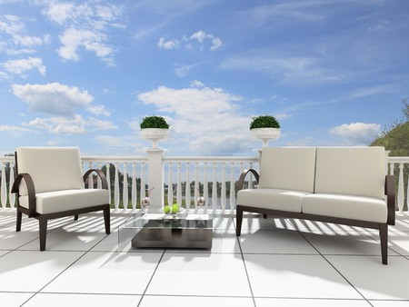 front or back yard: Armchairs and a table on an open terrace Stock Photo