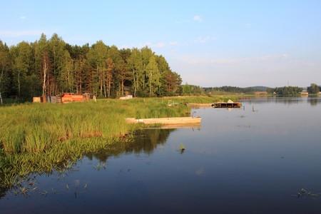 Boats at a mooring of beautiful lake photo