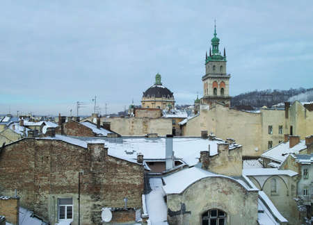 lvov: A panoramic view on winter Lvov, church and roofs covered with snow Stock Photo
