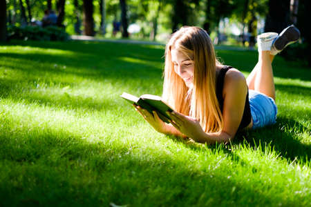 autodidact: a beautiful girl walks and engaged in self-education preparing for admission to the University