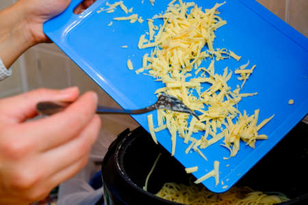 blue plaque: Grated tasty cheese with a blue plaque in Russian cuisine. Stock Photo
