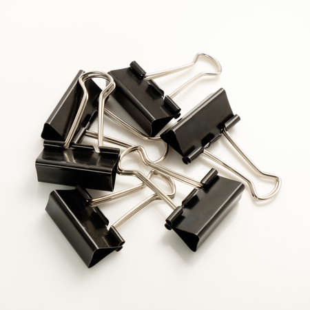 ferrous: Ferrous metal clips for office works on a white background. Stock Photo
