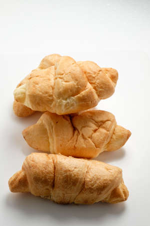 buttery: Delicious croissants on a white background for clipping under natural light