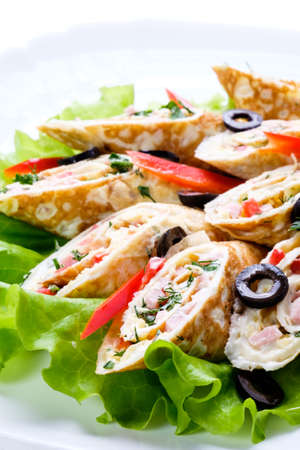 fresh food fish cake: Delicious specialties of the chef in a good restaurant, a pancake with salad on the white dish.