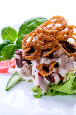 gourmet food: Delicious fresh dishes from the restaurant menu of fresh vegetables and products on a white dish.