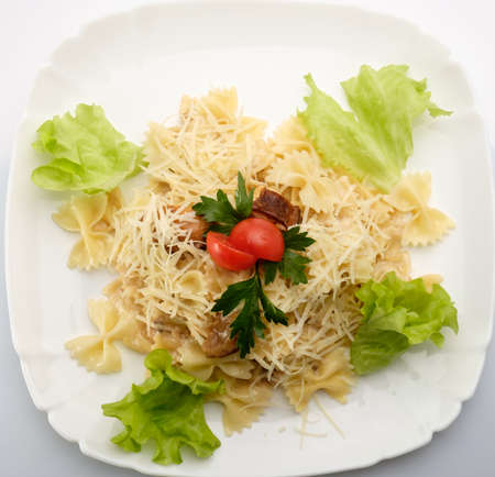 beautiful salad: Tasty and beautiful salad on a white plate with a white background, professional cooks prepared in the restaurant.