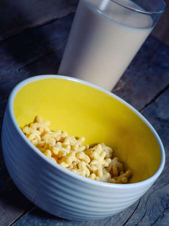 drenched: tasty corn flakes in a plate drenched milk yogurt. Stock Photo
